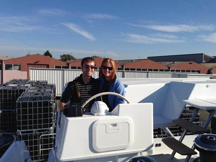 Amy and David at the helm of their new Fountaine Pajot catamaran.