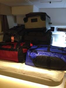The bags stacked up on our bed.