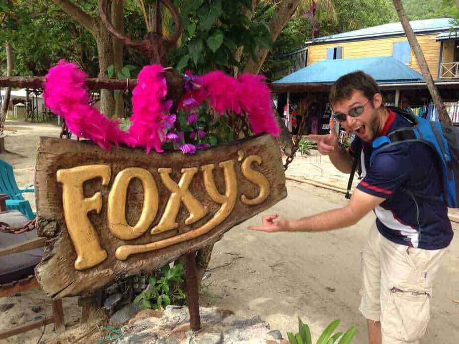 David pointing at the sign for Foxy's at Jost van Dyke, British Virgin Islands.
