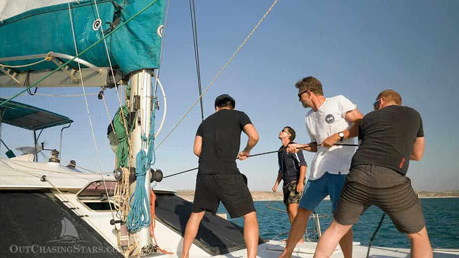 Hoisting the main sail on Sail Ningaloo.