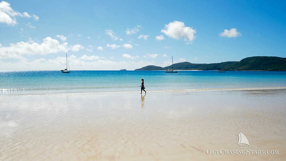 Amy walking across Whitehaven Beach on the Whitsunday Islands.